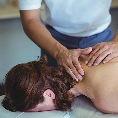 Physiotherapist-giving-neck-massage